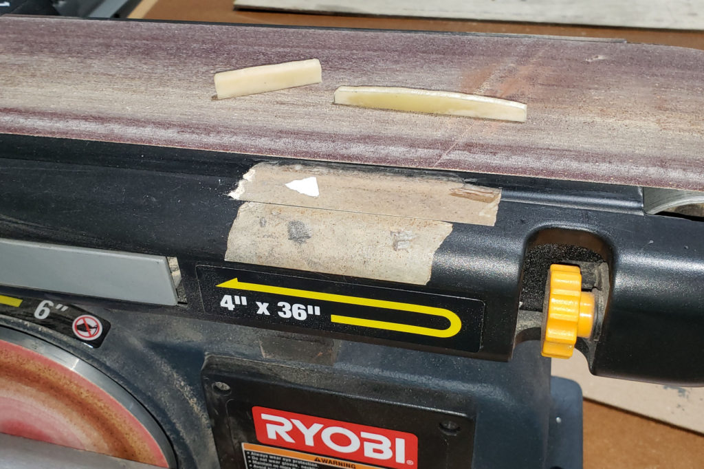 Using a belt sander to clean up shape